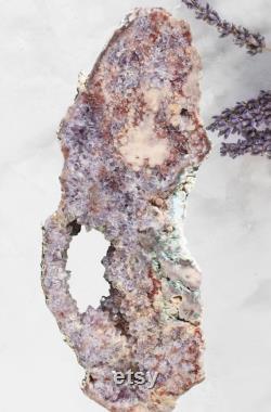 Pink amethyst slab on stand