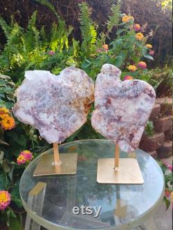 Pink amethyst slabs on golden stands