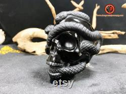 crystal skull. Crane in black obsidian. Crane and snakes. Natural Obsidian. Entirely handcrafted. 93 61 77mm